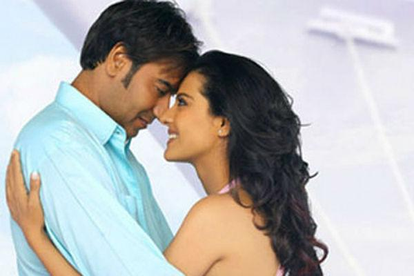 4. Ajay Devgn & Kajol<br><br>People say opposites attract and this couple is a prime example of the  same. While Kajol is outgoing and boisterous, Ajay is the total  opposite. This duo met during filming of the movie 'Hulchul' and love  blossomed. Soon after a whirlwind romance, they tied the knot in a  simple ceremony. They have acted in movies like 'U, Me & Hum',  'Pyaar Toh Hona Hi Tha' and the recent dud 'Toonpur Ka Superhero'.<br>