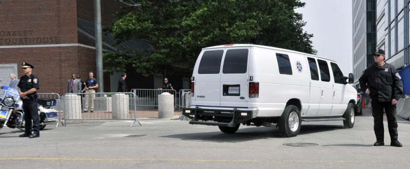 A U.S. Marshals Service van, believed to be carrying Boston Marathon bombing suspect Dzhokhar Tsarnaev, arrives at the federal courthouse for his arraignment Wednesday, July 10, 2013, in Boston. The April 15 attack killed three and wounded more than 260. The 19-year-old Tsarnaev has been charged with using a weapon of mass destruction, and could face the death penalty. (AP Photo/Josh Reynolds)