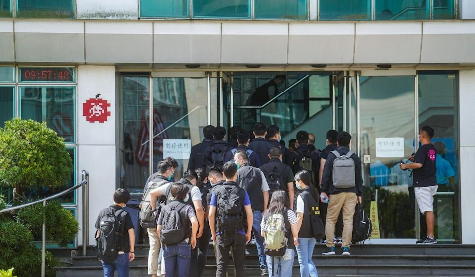 Police officers arrive at the Next Digital Limited building in Tseung Kwan O. Photo: Sam Tsang