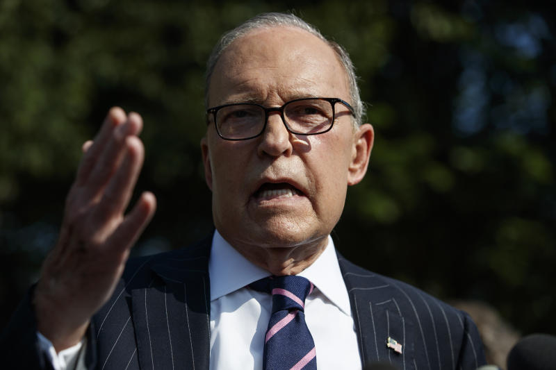 FILE - In this Aug. 6, 2019, file photo, White House chief economic adviser Larry Kudlow talks with reporters outside the White House in Washington. Where past presidents have relied on top academics, business leaders and officials with experience in prior administrations, Trump has gone a different route. He's built crew of camera-ready economic advisers, rather than one known for its policy chops.  (AP Photo/Evan Vucci, File)