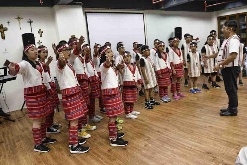 Dressed in traditional costumes, the children belt out songs that echo the wisdom of their Atayal ancestors.
