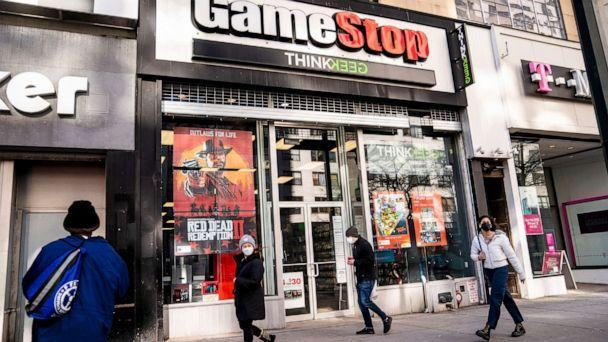 PHOTO: Pedestrians pass a GameStop store in New York City, Jan. 28, 2021. (John Minchillo/AP, FILE)