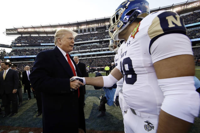 President Donald Trump meets with Navy player Anthony Gargiulo ahead of the Army-Navy game on Dec. 8 in Philadelphia. (AP Photo/Matt Rourke)