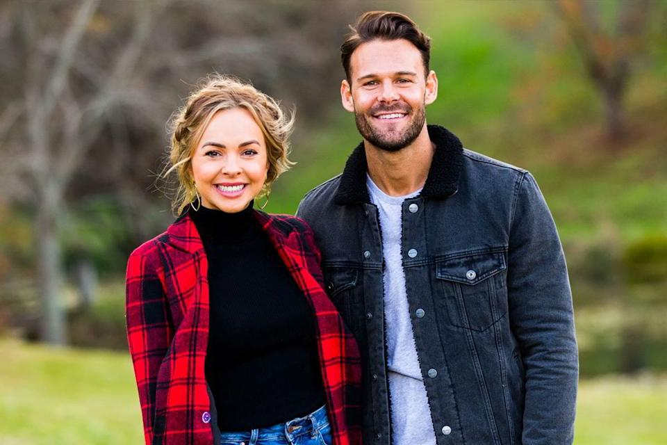 Bachelorette star Angie Kent and contestant Carlin Sterritt pose together outdoors