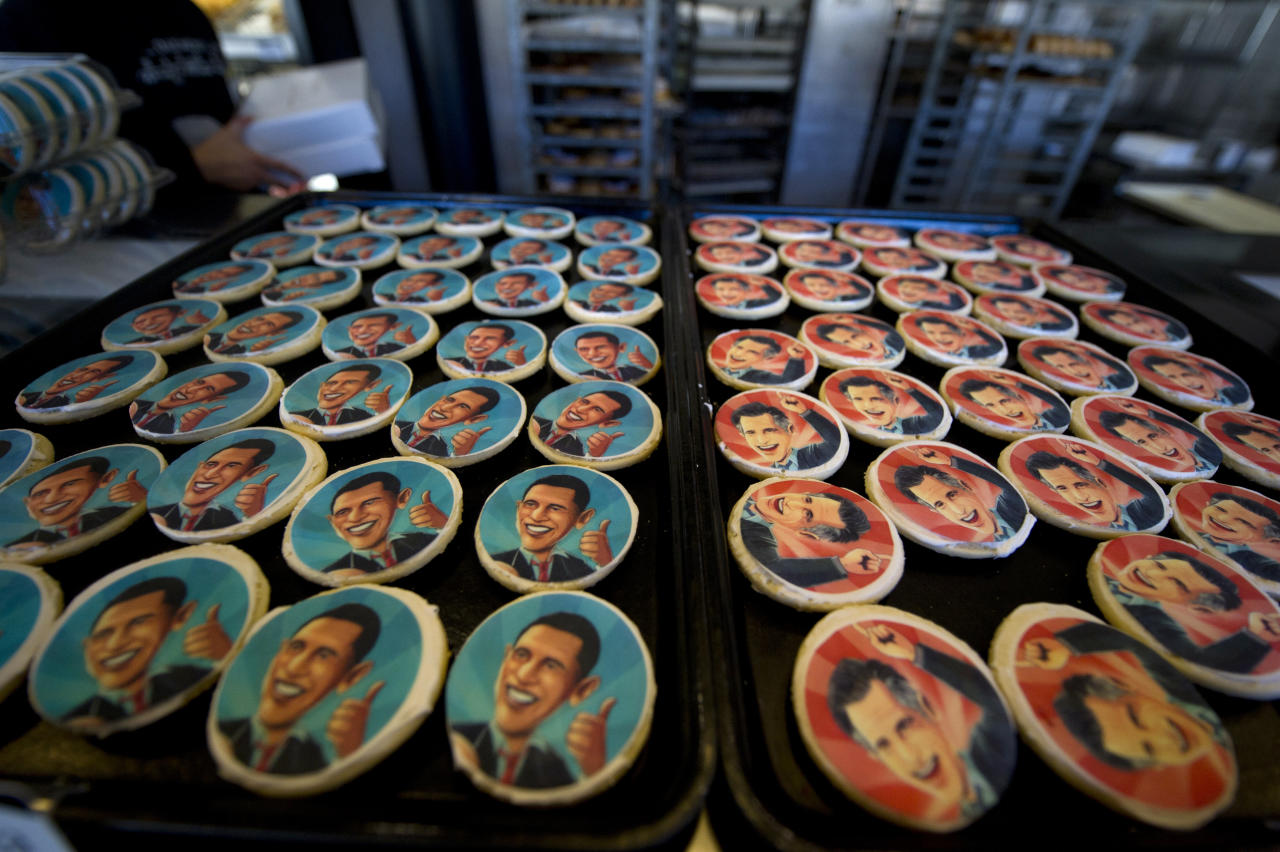 Obama and Romney cookie trays beckon shoppers at the Oakmont Bakery on November 6, 2012 in Oakmont, Pennsylvania. Cookie purchase polls reveal customers have purchased 2,332 Romney cookies while 1,745 Obama cookies have been sold. As Americans are heading to the ballots, polls show that U.S. President Barack Obama and Republican presidential candidate Mitt Romney are in a tight race. (Photo by Jeff Swensen/Getty Images)