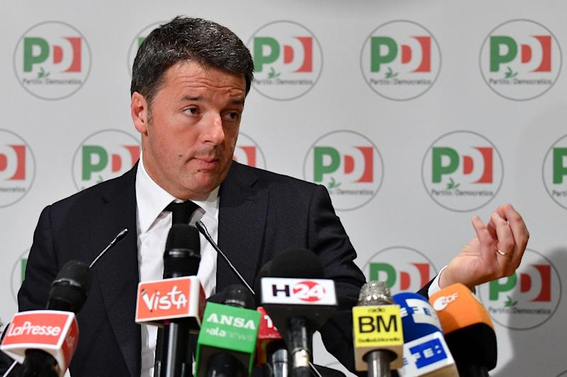 Former Italian prime minister Matteo Renzi stepped down as leader of the centre-left Democratic Party over the election defeat (AFP Photo/Alberto PIZZOLI)