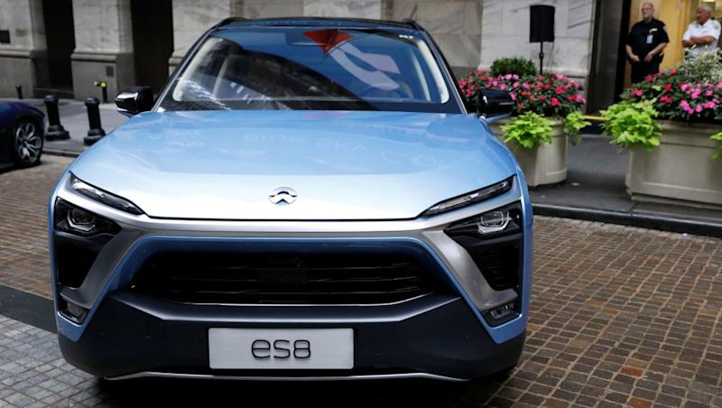 Chinese electric vehicle start-up Nio Inc. vehicles are on display in front of the New York Stock Exchange (NYSE) to celebrate the company's initial public offering (IPO) in New York, U.S., September 12, 2018. REUTERS/Brendan McDermid - RC17A0FF9580