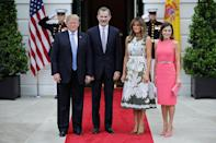 Standing alongside her husband, King Felipe VI and Queen Letizia of Spain for the Spanish royal visit, Melania wore a stunning Valentino olive green dress with intricate white floral embroidery, accessoritisng with a white crocodile belt and Manolo Blahniks. [Photo: Getty]
