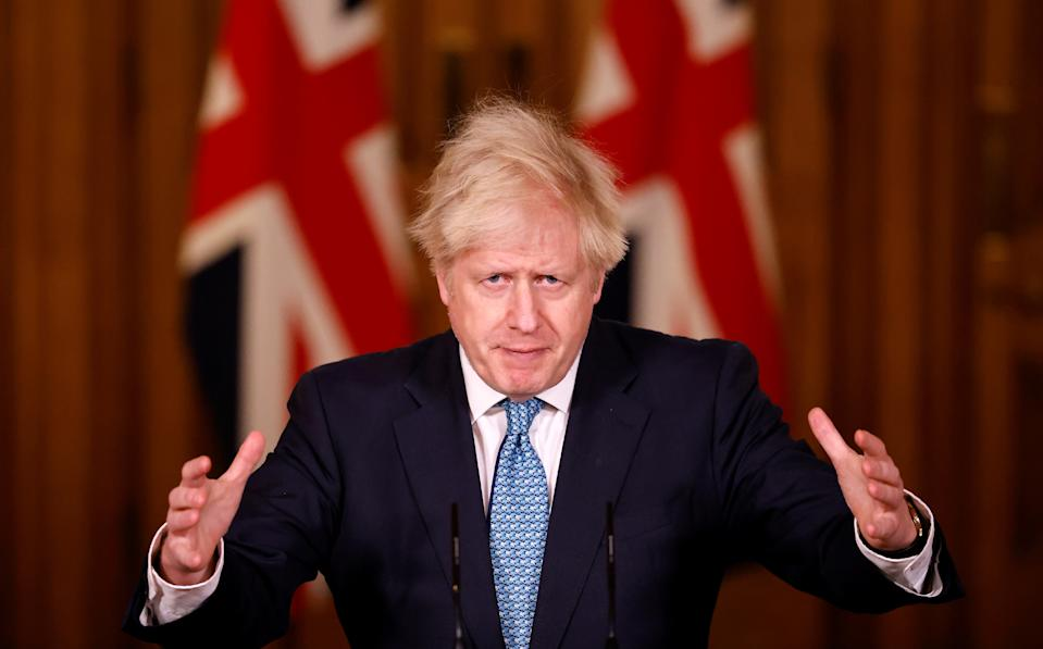 Boris Johnson at Monday's Downing Street press conference. (Tolga Akmen/PA)