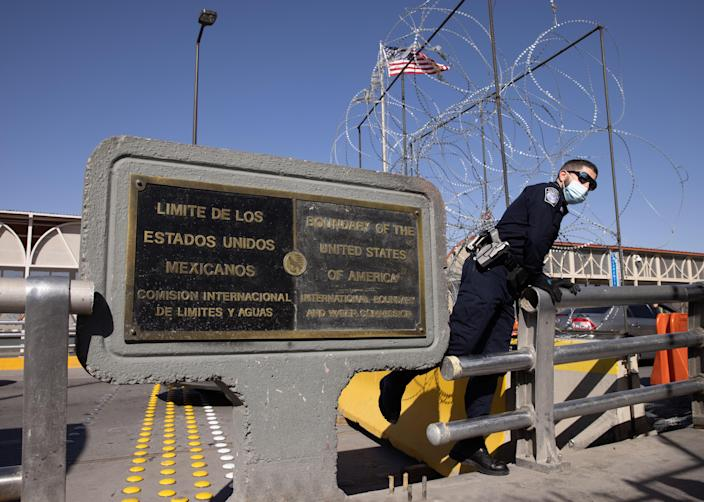 A U.S. Customs and Border Protection officer awaits immigrants crossing into the United States on March 16, 2021 in Ciudad Juarez, Mexico. / Credit: John Moore / Getty Images