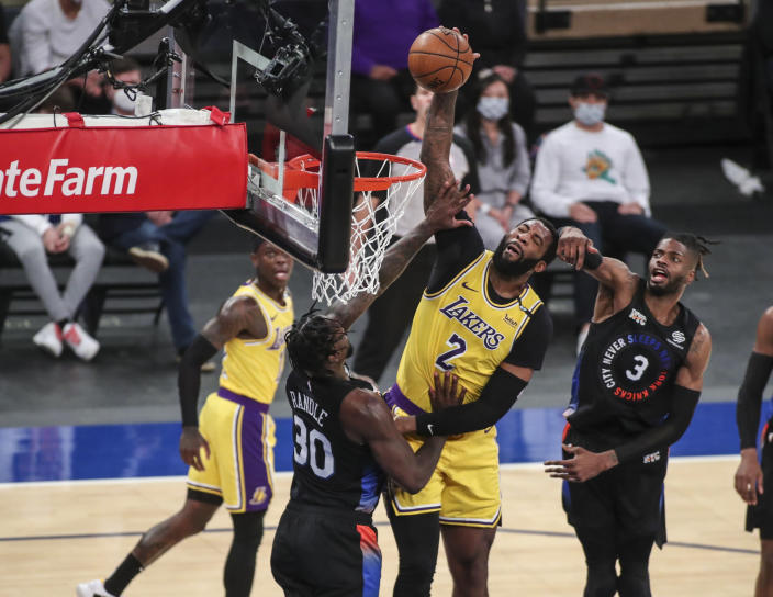 Los Angeles Lakers center Andre Drummond (2) dunks against the New York Knicks in the second quarter of an NBA basketball game at Madison Square Garden in New York, Monday, April 12, 2021. (Wendell Cruz/Pool Photo via AP)