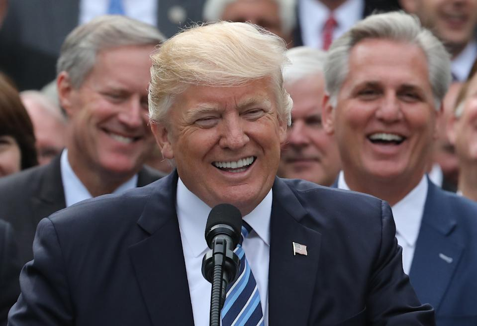 U.S. President Donald Trump speaks with House Freedom Caucus Chairman Mark Meadows (L) and House Majority Leader Kevin McCarthy (R) behind him as Trump gathered with Congressional Republicans in the Rose Garden of the White House after the House of Representatives approved the American Healthcare Act, to repeal major parts of Obamacare and replace it with the Republican healthcare plan, in Washington, U.S., May 4, 2017. REUTERS/Carlos Barria