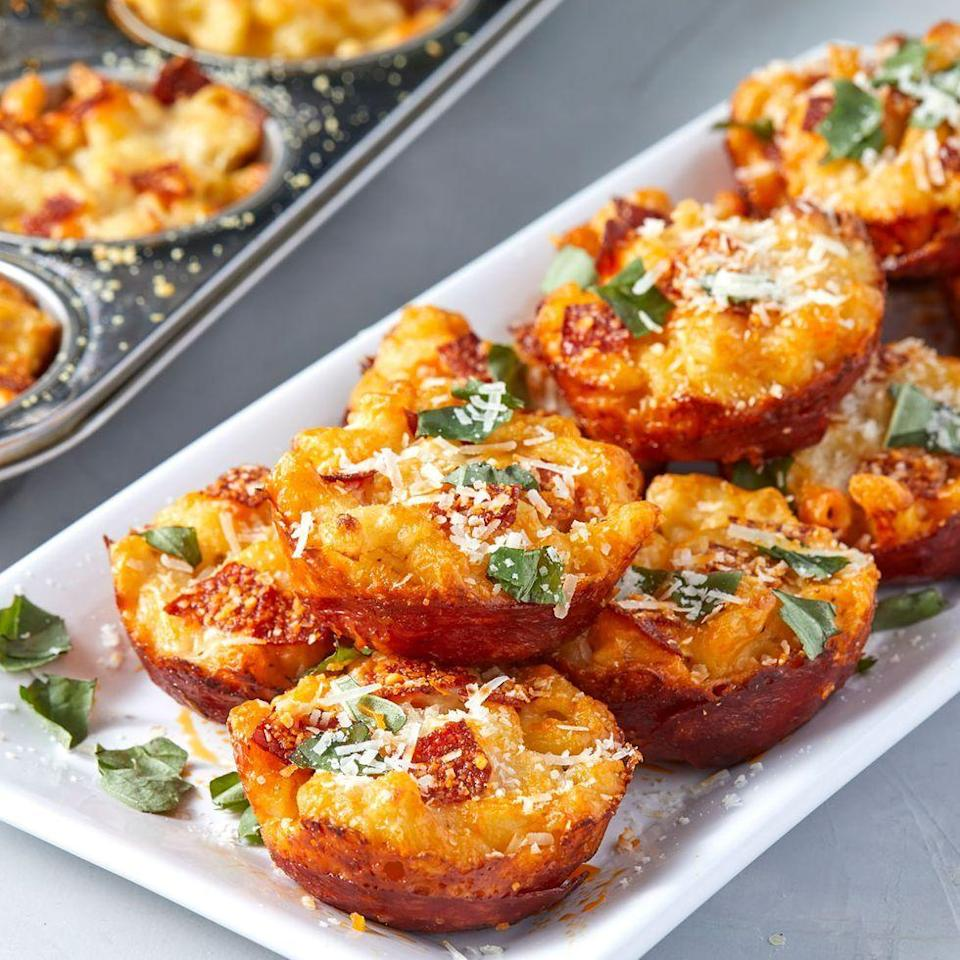 """<p>Held together by pepperoni, these mac and cheese bites are a pizza lover's dream. Creamy mac, pepperoni, and plenty of Parm. What's not to love? </p><p>Get the <a href=""""https://www.delish.com/uk/cooking/recipes/a30992624/mac-and-cheese-pizza-bites-recipe/"""" rel=""""nofollow noopener"""" target=""""_blank"""" data-ylk=""""slk:Mac & Cheese Pizza Bites"""" class=""""link rapid-noclick-resp"""">Mac & Cheese Pizza Bites</a> recipe.</p>"""