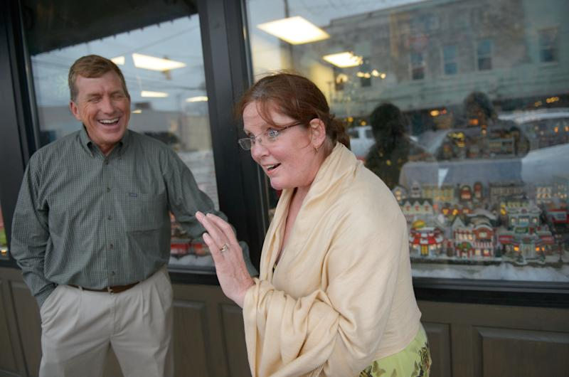 """This Dec. 21, 2013 photo shows The Gingerbread House owner Mike Walsworth, left, laughing at a joke by Marilyn Lovett, 57, about the """"Duck Dynasty"""" controversy in West Monroe, La. The town is the setting for the popular """"Duck Dynasty""""series, where show patriarch, Phil Robertson, was suspended last week for disparaging comments he made to GQ magazine about gay people. (AP Photo/Matthew Hinton)"""