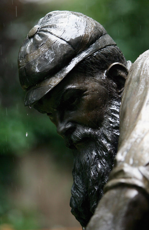 LONDON - JULY 24: Rain falls on the statue of W.G Grace during day four of the first npower Ashes Test match between England and Australia at Lord's on July 24, 2005 in London.  (Photo by Mike Hewitt/Getty Images)