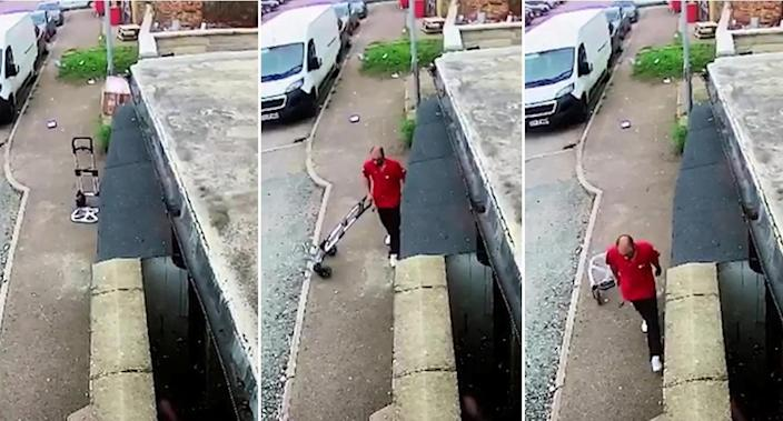 The DPD driver was caught on camera throwing the fragile parcel over a wall (swns)