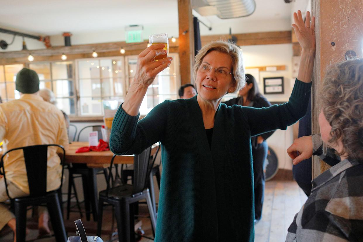 Sen. Elizabeth Warren samples a beer at a brewery in New Hampshire, March 15, 2019. (Photo: Brian Snyder/Reuters)