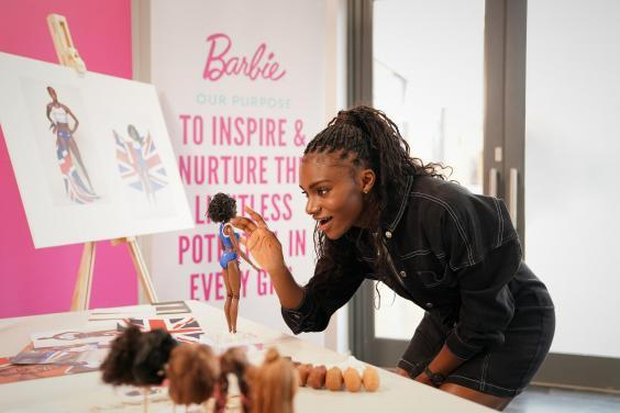 Dina Asher-Smith said the doll is 'definitely up there' as one of her greatest achievements (Mattel)