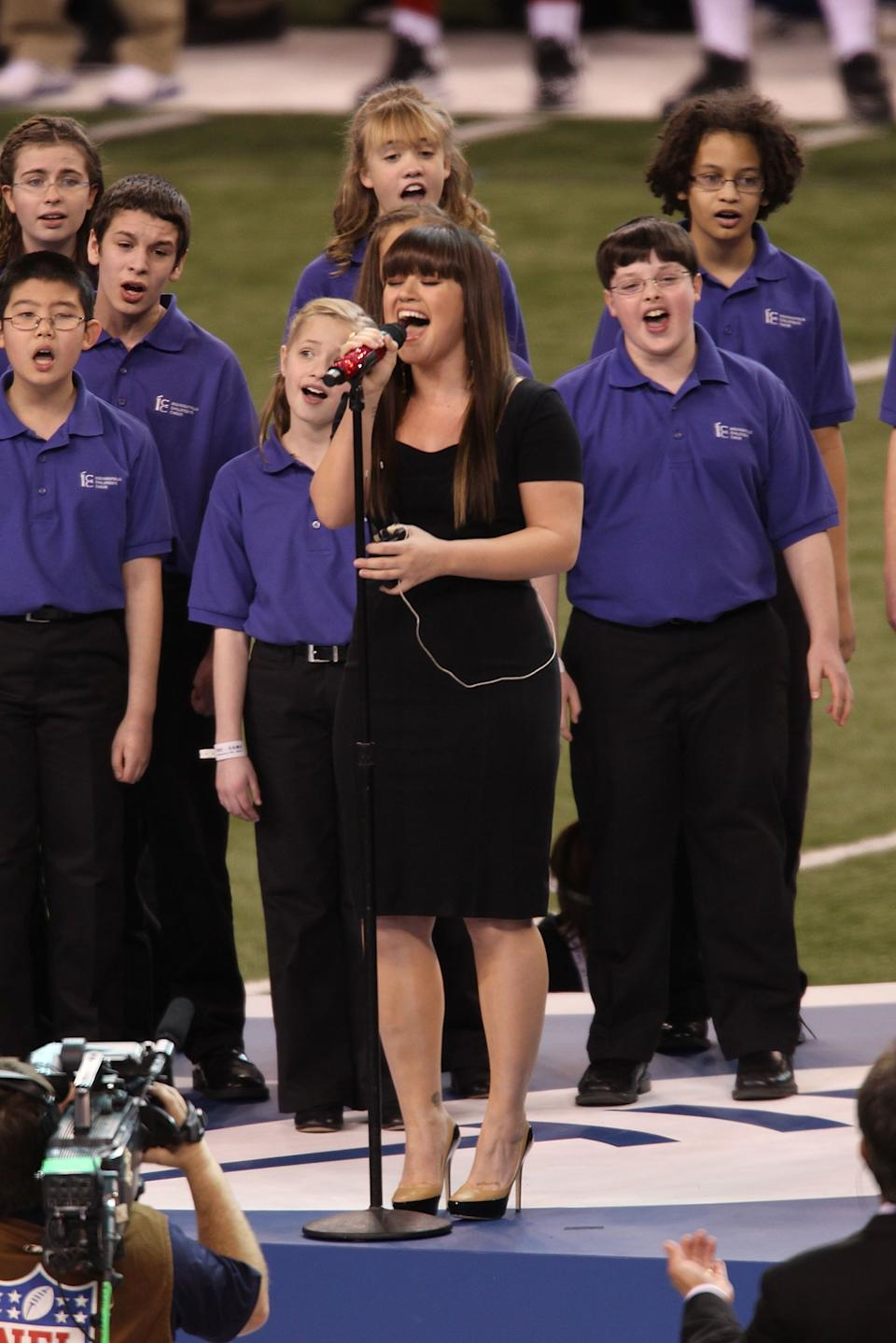 Kelly Clarkson performs the National Anthem during the Bridgestone Super Bowl XLVI Pregame Show at Lucas Oil Stadium on February 5, 2012 in Indianapolis, Indiana.