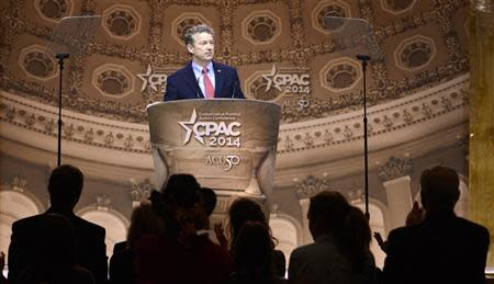 Senator Rand Paul (R-KY) pauses in his remarks as guests applaud at the Conservative Political Action Conference (CPAC) in Oxon Hill