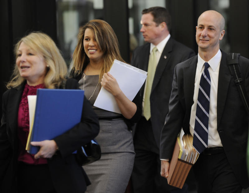 William Balfour's defense team arrives at the Cook County Courthouse on the first day of the murder trial of Balfour, in Chicago, Monday, April 23, 2012. Balfour is charged with three counts of first-degree murder in the Oct. 24, 2008, slayings Oscar winning actress and singer Jennifer Hudson's mother, brother and nephew. (AP Photo/Paul Beaty)