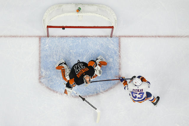 New York Islanders' Casey Cizikas (53) tries to score against Philadelphia Flyers' Brian Elliott (37) during the first period of an NHL hockey game, Saturday, Nov. 16, 2019, in Philadelphia. (AP Photo/Matt Slocum)