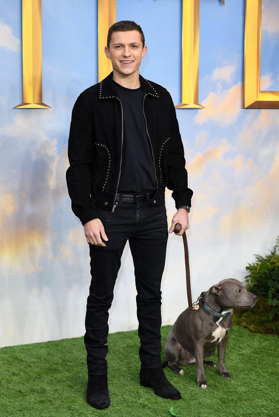 <p>All-black everything is always a winning look, particularly when it's elevated by a statement suede jacket and offset with a cute (if not slightly nervous-looking) dog in a complementary shade.</p>