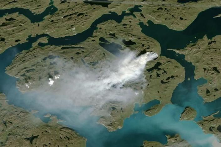 The risk of wildfires increases with warm, dry conditions(NOAA satellite photo showing cloud of smoke from wildfire in western Greenland) (AFP Photo/Handout)