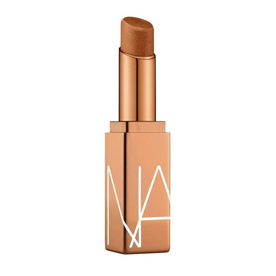"""<p><a class=""""link rapid-noclick-resp"""" href=""""https://www.narscosmetics.co.uk/en/afterglow-lip-balm/0194251005706.html"""" rel=""""nofollow noopener"""" target=""""_blank"""" data-ylk=""""slk:SHOP NOW"""">SHOP NOW</a><br><br>If you're after damage repair with a bit of added colour, go for a hybrid lip balm and lipstick such as <a href=""""https://www.narscosmetics.co.uk/en/afterglow-lip-balm/0194251005706.html"""" rel=""""nofollow noopener"""" target=""""_blank"""" data-ylk=""""slk:NARS Afterglow Lip Balm in Laguna - £23"""" class=""""link rapid-noclick-resp"""">NARS Afterglow Lip Balm in Laguna - £23</a>. <br></p>"""