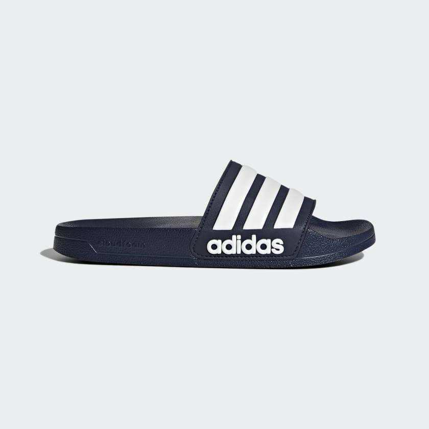 """<p><strong>adidas</strong></p><p>adidas.com</p><p><a href=""""https://go.redirectingat.com?id=74968X1596630&url=https%3A%2F%2Fwww.adidas.com%2Fus%2Fadilette-cloudfoam-slides%2FAQ1703.html&sref=https%3A%2F%2Fwww.menshealth.com%2Fstyle%2Fg32628591%2Fadidas-memorial-day-sneaker-sale%2F"""" rel=""""nofollow noopener"""" target=""""_blank"""" data-ylk=""""slk:BUY IT HERE"""" class=""""link rapid-noclick-resp"""">BUY IT HERE</a></p><p><del>$25<br></del><strong>$23</strong></p><p>OK, fine. These are not sneakers. But Adidas slides are the perfect timeless sandals that don't look dorky and are perfect for pooling, beaching, and walking the dog. You'll wear them forever. </p>"""