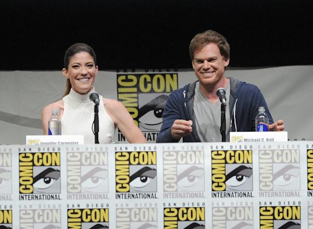 "SAN DIEGO, CA - JULY 18: Actors Jennifer Carpenter (L) and Michael C. Hall speak onstage at Showtime's ""Dexter"" panel during Comic-Con International 2013 at San Diego Convention Center on July 18, 2013 in San Diego, California. (Photo by Kevin Winter/Getty Images)"
