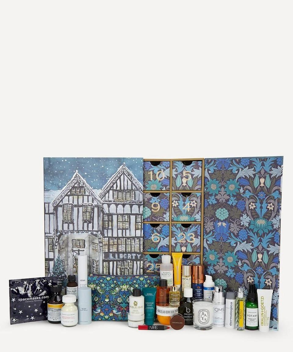 """<p>libertylondon.com</p><p><strong>$275.00</strong></p><p><a href=""""https://go.redirectingat.com?id=74968X1596630&url=https%3A%2F%2Fwww.libertylondon.com%2Fus%2Fbeauty-advent-calendar-2020-000708068.html&sref=https%3A%2F%2Fwww.townandcountrymag.com%2Fstyle%2Fbeauty-products%2Fnews%2Fg2919%2Fbeauty-advent-calendars%2F"""" rel=""""nofollow noopener"""" target=""""_blank"""" data-ylk=""""slk:Shop Now"""" class=""""link rapid-noclick-resp"""">Shop Now</a></p><p><strong>Best For: </strong>The beauty lover who doesn't believe in """"sample size""""</p><p><strong>What's Inside:</strong> 18 full-sized products (plus 8 minis) of coveted best-sellers like Diptyque Baies Mini Scented Candle, NARS Velvet Matte Lip Pencil in Dragon Girl, Sol de Janeiro Brazilian Bum Bum Cream, Susanne Kaufmann Herbal Whey Bath, and Herbivore Prism 20% AHA 5% BHA Exfoliating Glow Facial. </p>"""