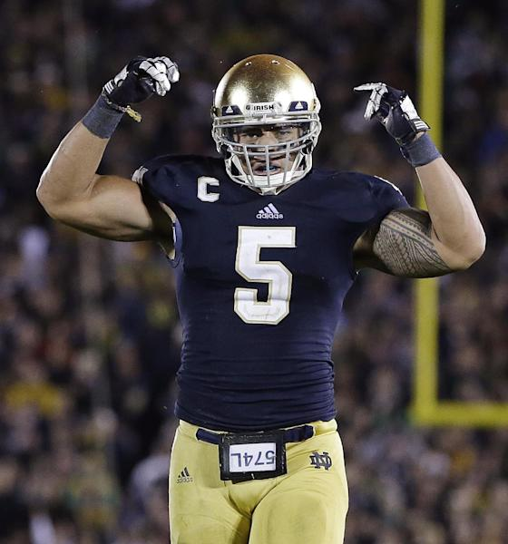 Notre Dame's Manti Te'o reacts following a tackle during the second half against Michigan during an NCAA college football game on Saturday, Sept. 22, 2012, in South Bend, Ind. Notre Dame defeated Michigan 13-6. (AP Photo/Darron Cummings)