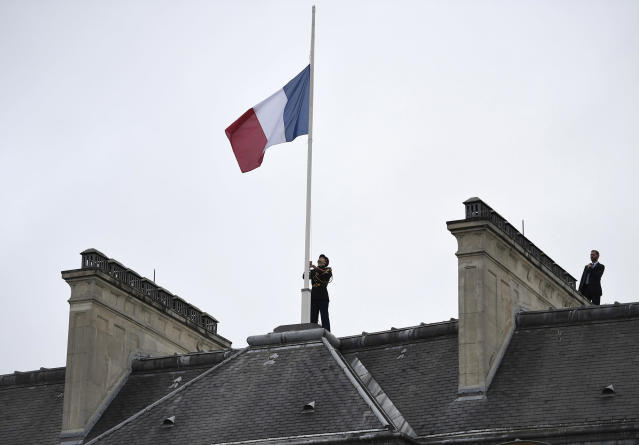 <p>A Republican Guard flies the French flag at half mast at the Elysee presidential Palace, Wednesday May 24, 2017 in Paris, in tribute to the victims of the terror attack at the Ariana Grande concert in Manchester. (Stephane de Sakutin, Pool via AP) </p>