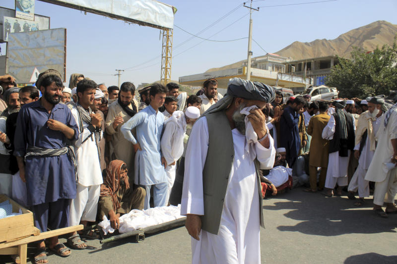 An Afghan elderly man cries near bodies of those who were killed in an airstrike during a protest in Baghlan province, northern Afghanistan, Tuesday, July 9, 2019. Even as an All-Afghan conference that brought Afghanistan's warring sides together was ending, the airstrike killed seven people, six of them children. (AP Photo/Mehrab Ibrahimi)