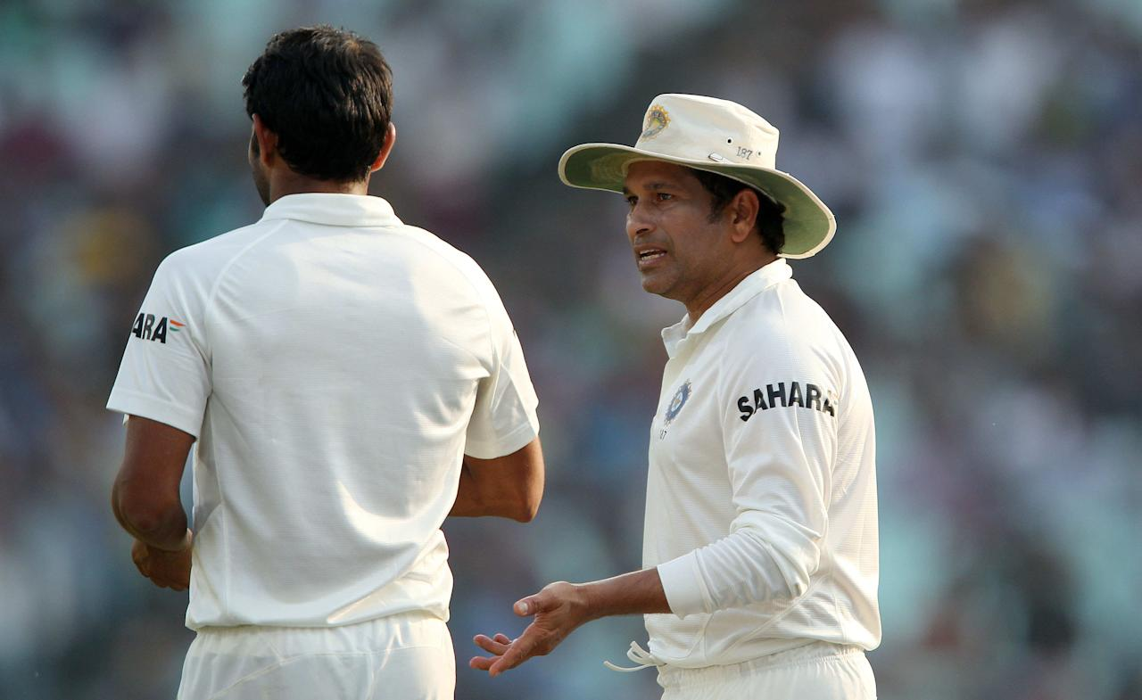 Sachin Tendulkar of India offers Mohammed Shami some advice during day three of the first Star Sports test match between India and The West Indies held at The Eden Gardens Stadium in Kolkata, India on the 8th November 2013  Photo by: Ron Gaunt - BCCI - SPORTZPICS