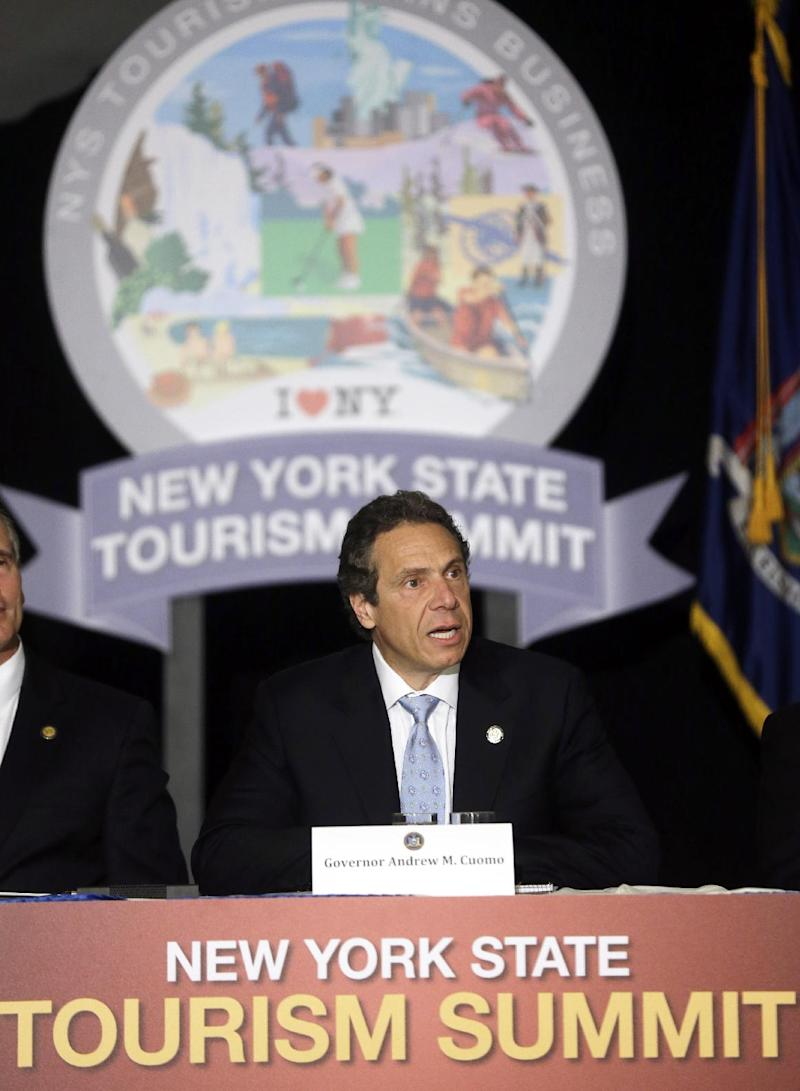 New York Gov. Andrew Cuomo speaks during the New York State Tourism Summit on Wednesday, May 8, 2013, in Albany, N.Y.  The governor is trying to map out a better way to showcase New York state's seasonal attractions and boost businesses. The focus will range from summer attractions such as Niagara Falls, the Erie Canal and Adirondacks to the rebuilding of boardwalks and beaches on Long Island hit hard by Superstorm Sandy last fall. (AP Photo/Mike Groll)