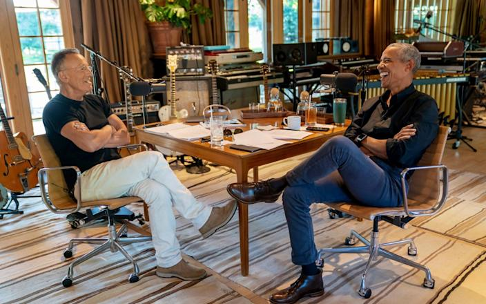 Bruce Springsteen, left, appears with former President Barack Obama during their podcast of conversations recorded at Springsteen's home studio in New Jersey. - Spotify