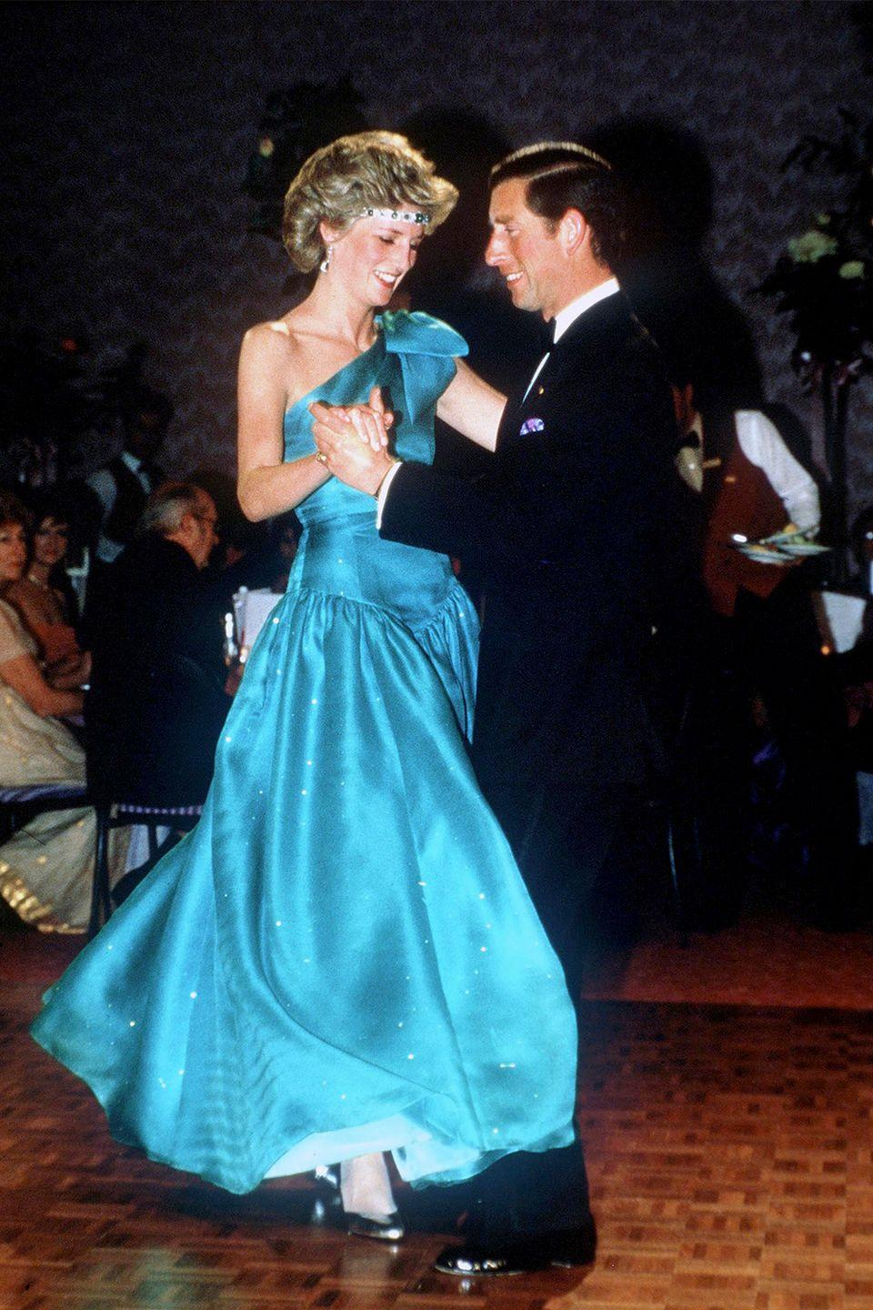 <p>During a 1985 visit to Melbourne with Prince Charles, Diana accessorized her gown with a makeshift tiara: the Princess strung an emerald-and-diamond choker across her forehead. </p>