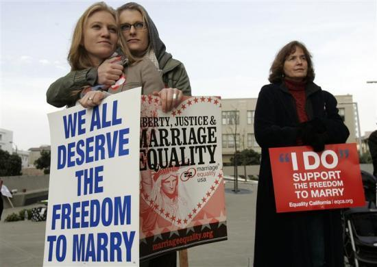 Same-sex couple Elizabeth Chase (L) and Kate Baldridge stand outside the federal courthouse in San Francisco, California January 11, 2010. California's ban on gay marriage went to trial in a federal case that plaintiffs hope to take all the way to the U.S. Supreme Court and overturn bans throughout the nation.