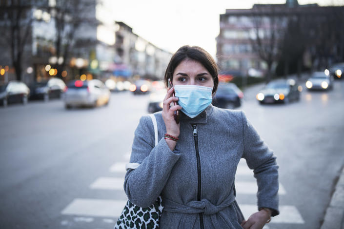 Masks may stop infected patients spreading the virus. Coronavirus sufferers should 'self isolate' by staying indoors as much as possible. (Getty Images)