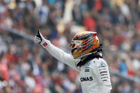 Formula One - F1 - Chinese Grand Prix - Shanghai, China - 08/04/17 - Mercedes driver Lewis Hamilton of Britain reacts after setting pole position in qualifying at the Shanghai International Circuit. REUTERS/Aly Song