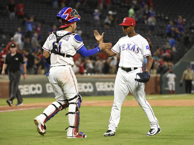 Texas Rangers catcher Robinson Chirinos and relief pitcher Jose Leclerc celebrate after Leclerc struck out Los Angeles Angels' Eric Young Jr. for the final out of a baseball game Thursday, Aug. 16, 2018, in Arlington, Texas. Texas won 8-6. (AP Photo/Jeffrey McWhorter)