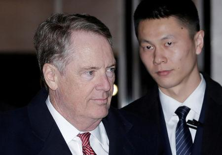 FILE PHOTO: U.S. trade representative Robert Lighthizer, a member of the U.S. trade delegation to China, walks past a Chinese security personnel upon his arrival at a hotel in Beijing