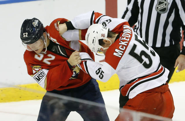 Florida Panthers defenseman MacKenzie Weegar (52) and Carolina Hurricanes defenseman Roland McKeown (55) fight in the second period of an NHL hockey game, Monday, April 2, 2018, in Sunrise, Fla. (AP Photo/Joe Skipper)