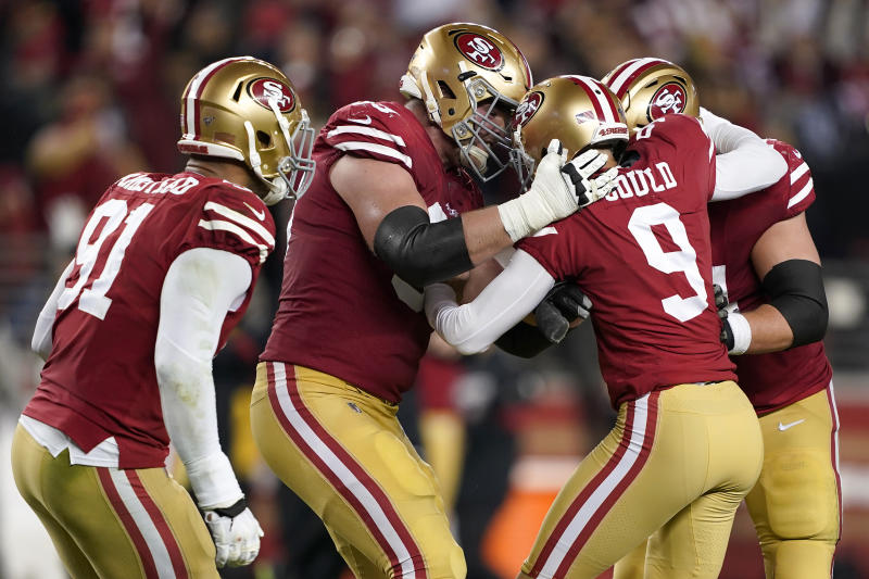 San Francisco 49ers kicker Robbie Gould (9) is congratulated by teammates after kicking the game-winning field goal against the Los Angeles Rams during the second half of an NFL football game in Santa Clara, Calif., Saturday, Dec. 21, 2019. (AP Photo/Tony Avelar)