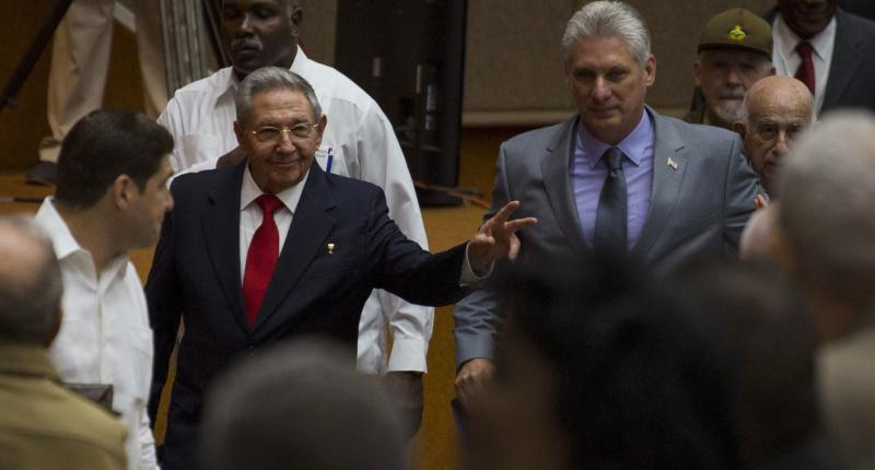 Cuba's President Raul Castro, center left, enters the National Assembly followed by his successor Miguel Diaz-Canel. (AP)