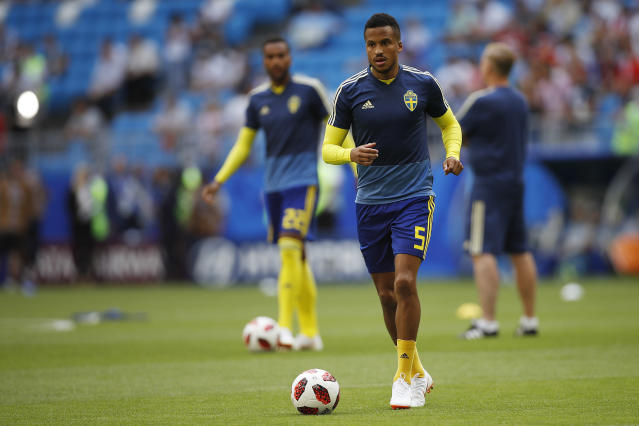 <p>Sweden's Martin Olsson warms up </p>