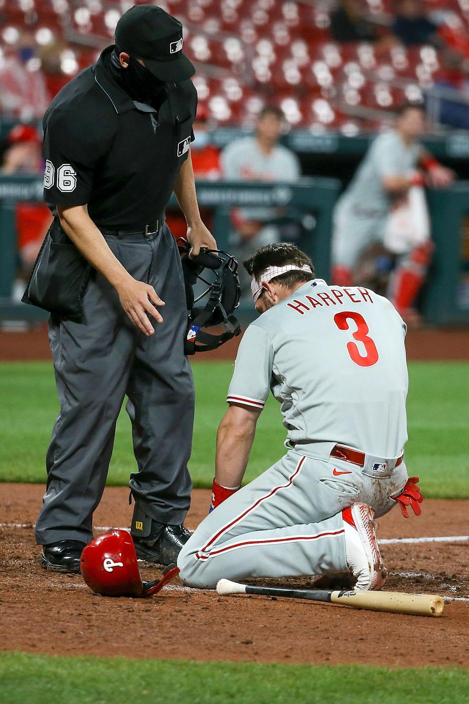 Bryce Harper reacts after getting hit in the face by a pitch on April 28.