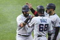 Miami Marlins' Sandy Leon, left, is greeted at home plate by Lewin Diaz (68)and Isan Diaz after hitting a three-run home run during the second inning off Baltimore Orioles starting pitcher Spenser Watkins during a baseball game Tuesday, July 27, 2021, in Baltimore. (AP Photo/Terrance Williams)